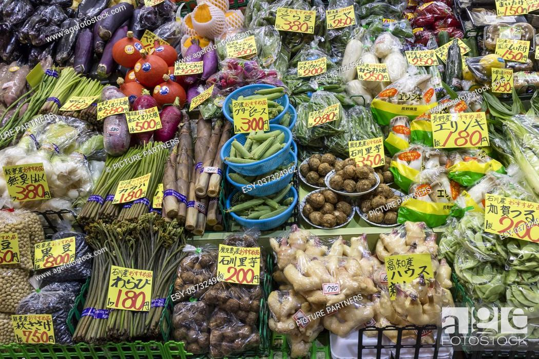 Photo de stock: Variety of fresh vegetables and price tags at the Omicho Market.