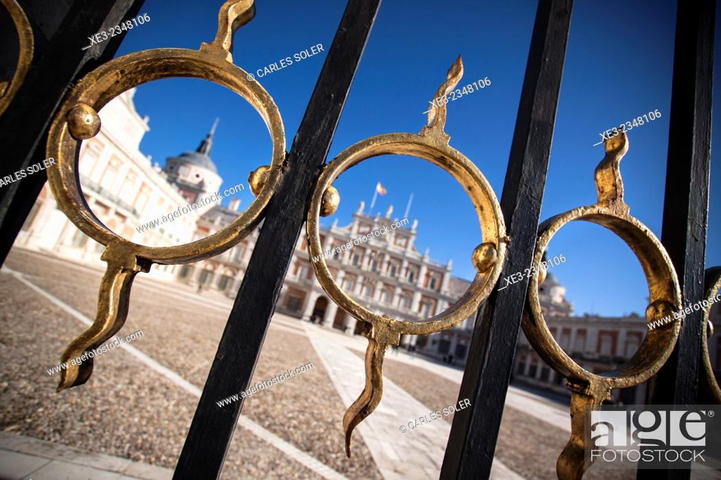 Stock Photo: Spain, Madrid Province, Aranjuez, View of Royal Palace through architectural details of gate.