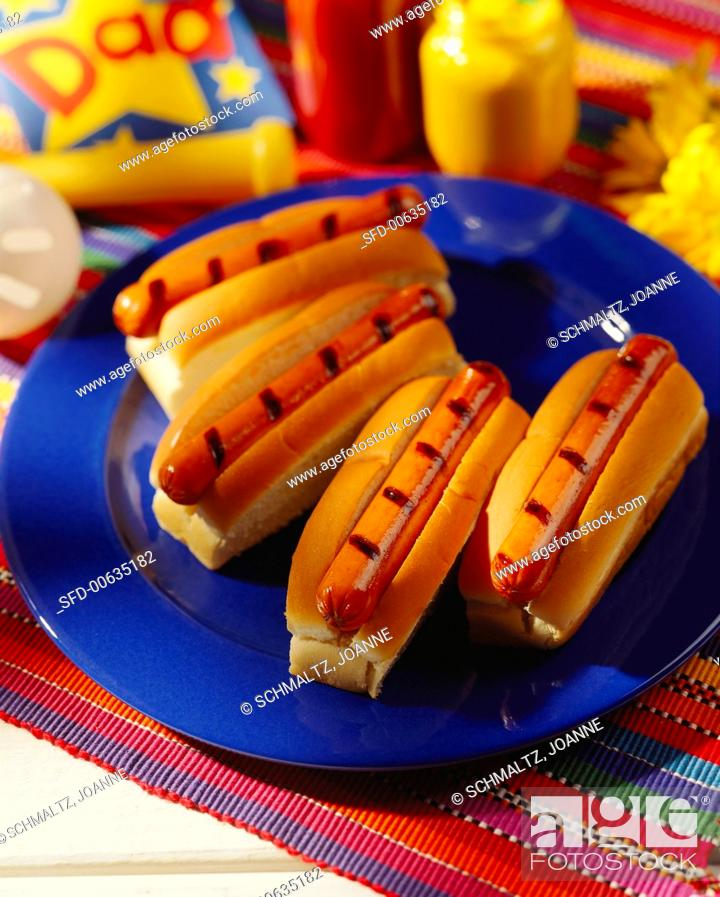 Stock Photo: Four Grilled Hot Dogs.