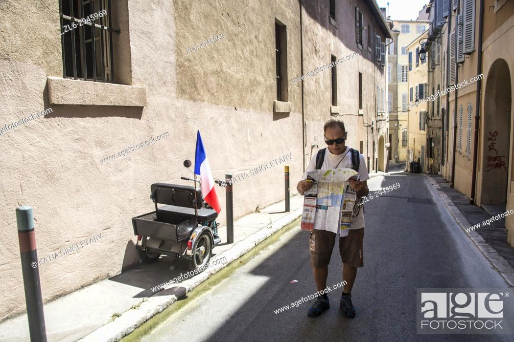 Stock Photo: Tourist in Quarter of Le Panier in Marseilles. Old streets in the neighboroud of Le Panier. Marseille, Provence-Alpes-Côte d'Azur, France.