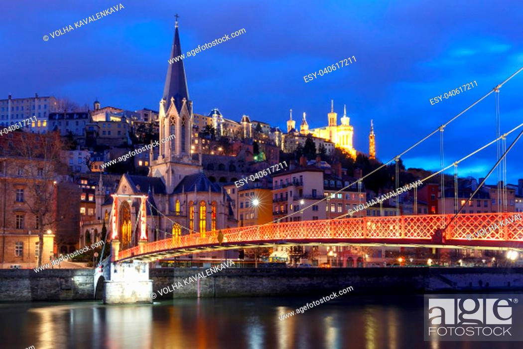 Stock Photo: Panoramic view of Saint Georges church and footbridge across Saone river, Old town with Fourviere cathedral during evening blue hour in Lyon, France.