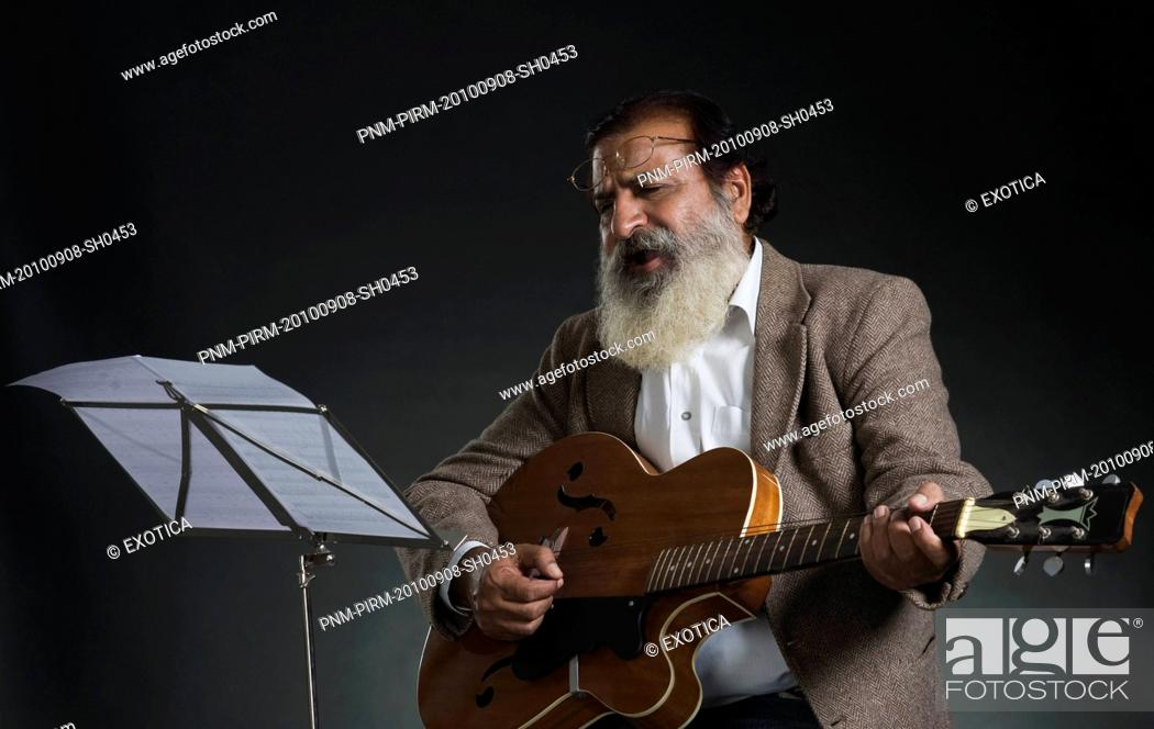 Stock Photo: Guitarist performing in a musical concert.