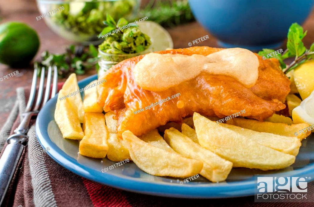 Stock Photo: Fish and chips, homemade delicious with pesto from peas.