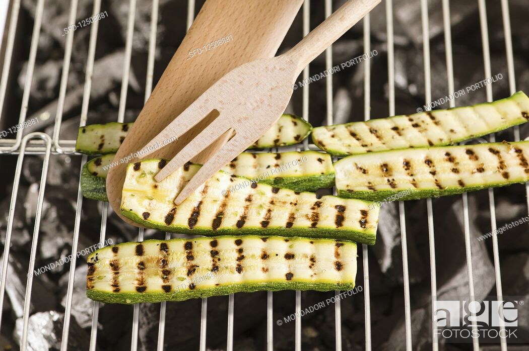 Stock Photo: Courgette slices on a grill.