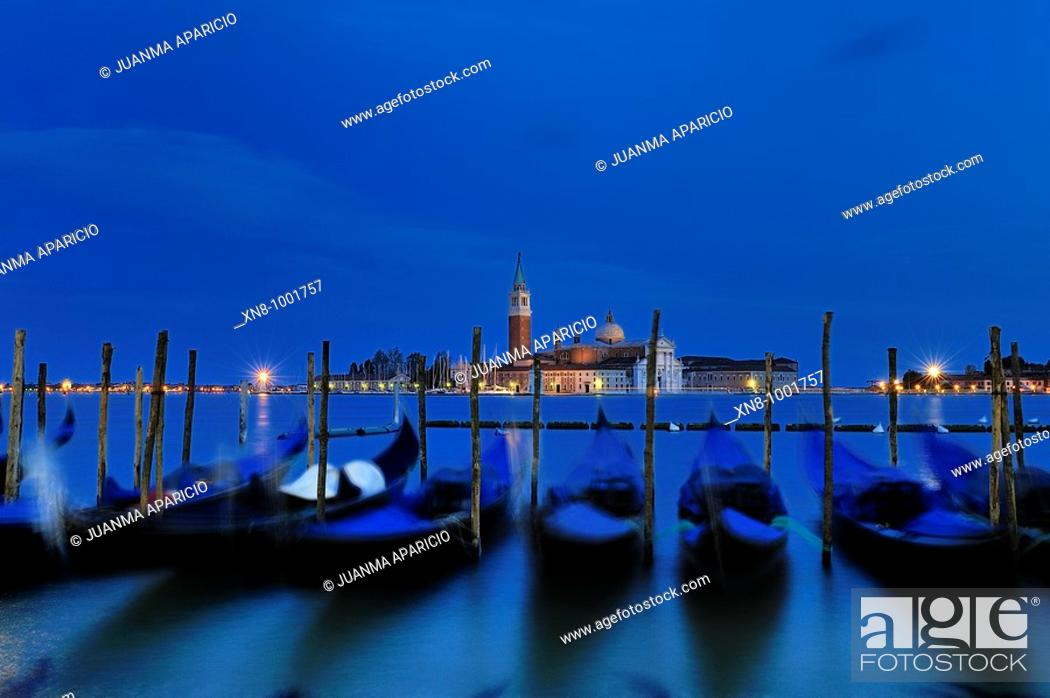 Stock Photo: Venetian Gondolas bobbing in the night.