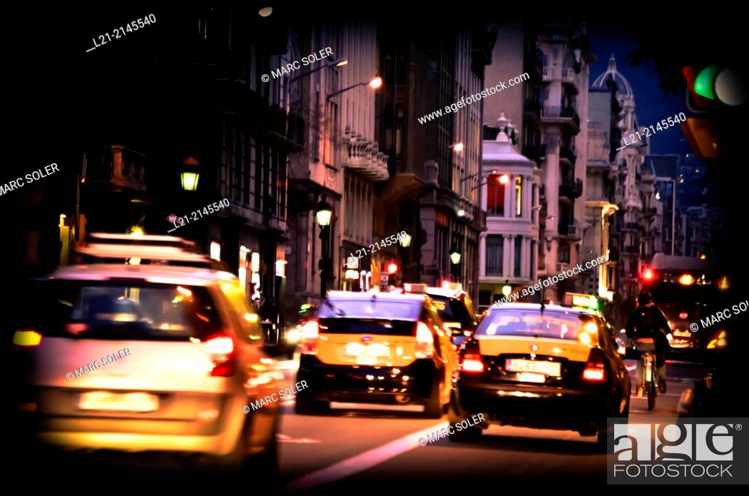 Stock Photo: Traffic at street, taxis, night. Barcelona, Catalonia, Spain.