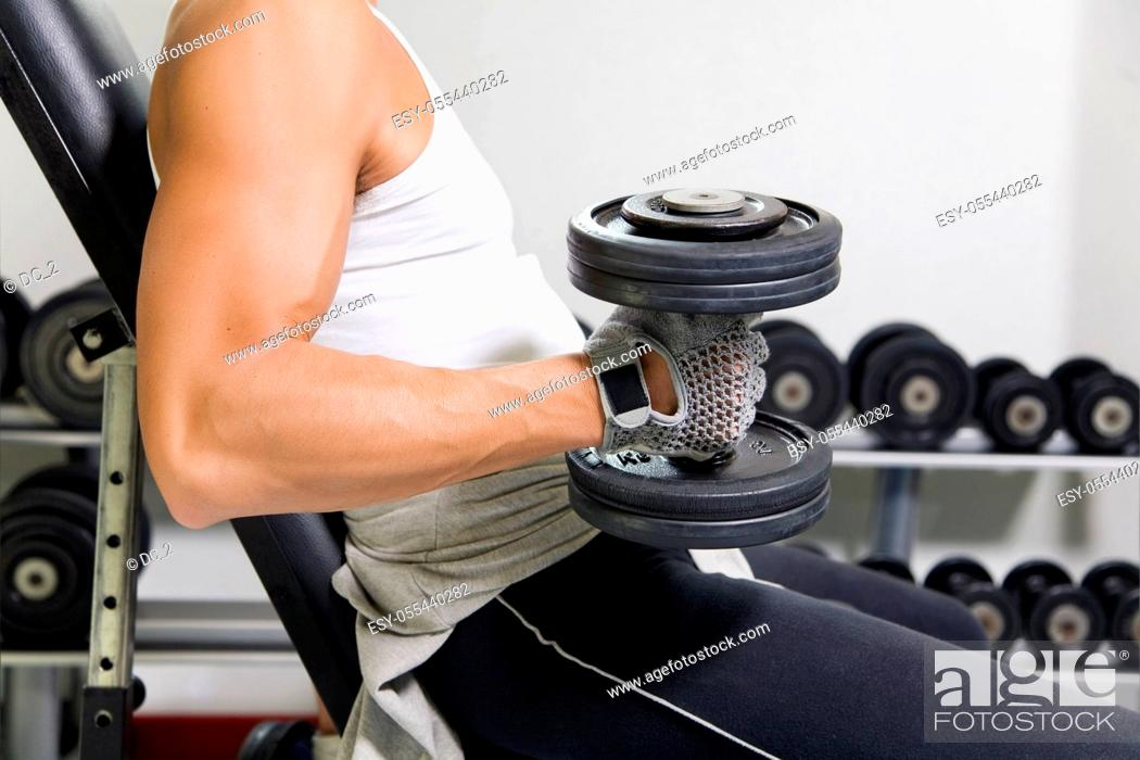 Stock Photo: muscle sports, bodybuilder, dumbbell training.