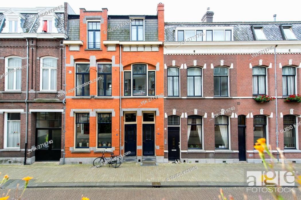 Stock Photo: Tilburg, Netherlands. Facades of one century old residential houses in the down town area of the 6th city of the country.