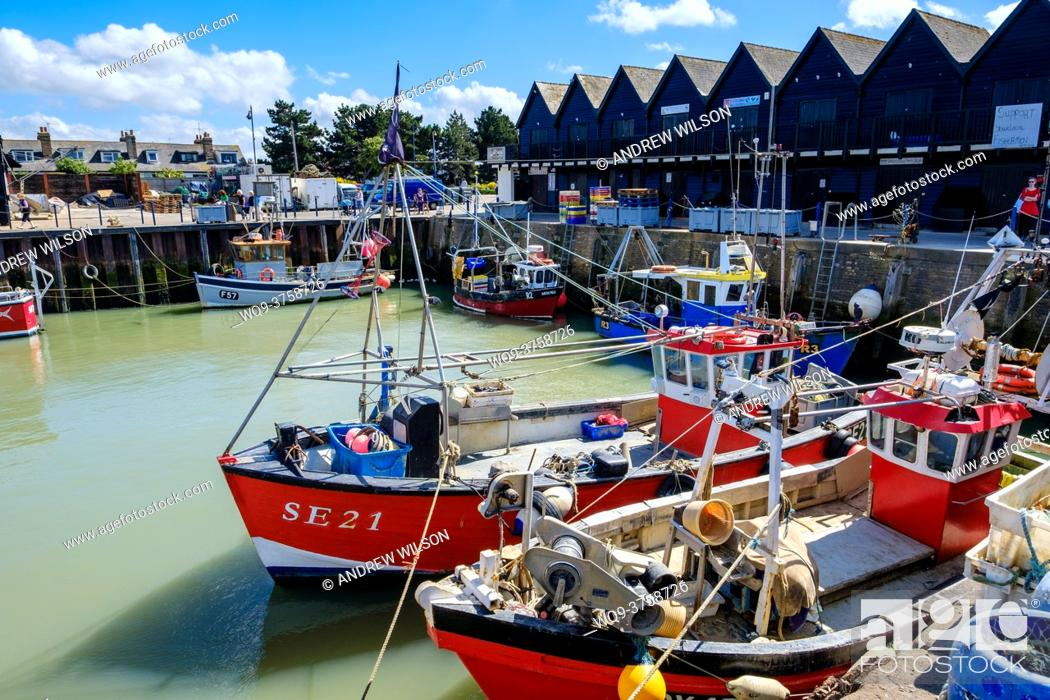 Stock Photo: Fishing boats tied up in the harbour at Whitstable, Kent, England.