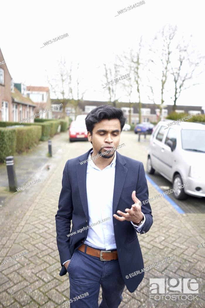 Stock Photo: Indian business man feeling his thoughtful mind in Leeuwarden, Friesland, Netherlands, Europe.