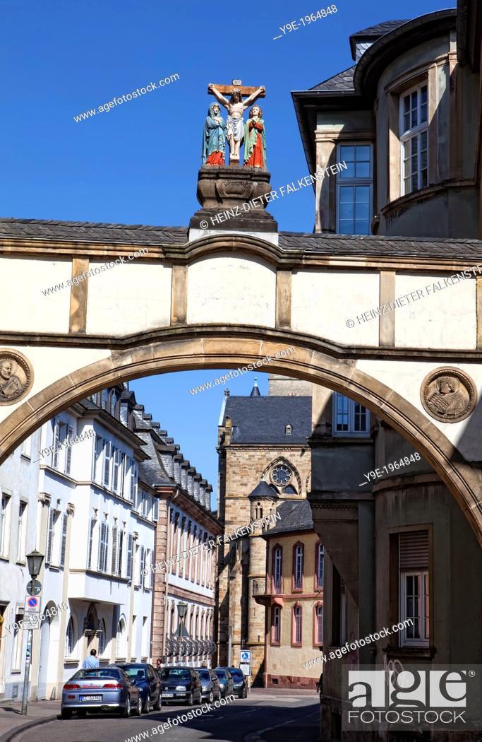 Len Trier archway with a crucifixion near liebfrauenbasilika church