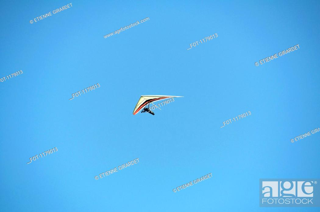 Stock Photo: Hang glider against a clear blue sky.