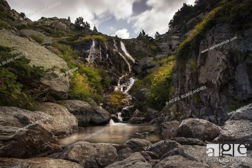 Stock Photo: Hiking up to the Juclar lake, small waterfall of the Juclar river, pyrenees mountain range, Andorra.