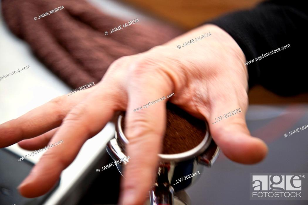 Stock Photo: Person making fresh coffee with expresso machine.