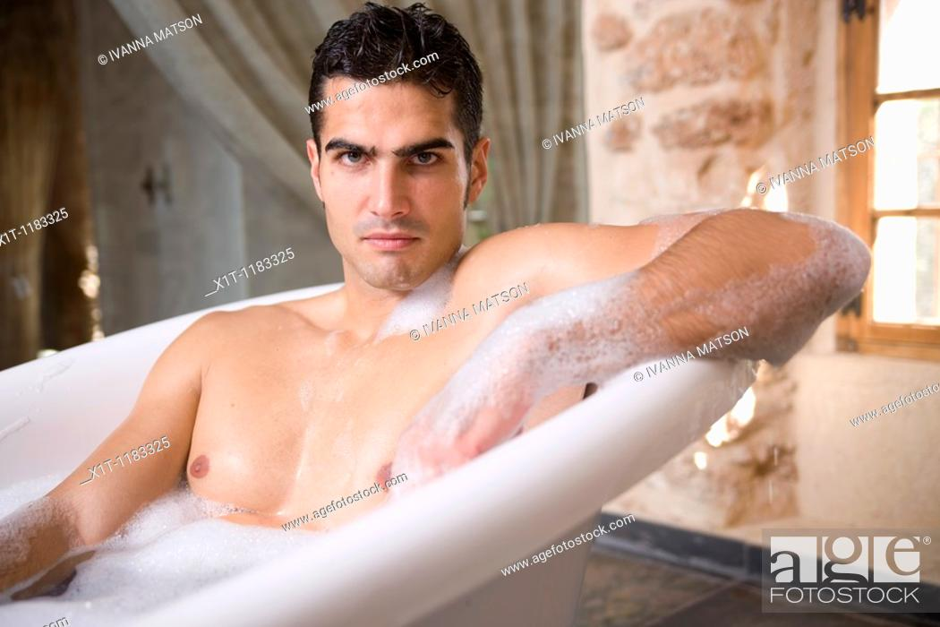 Stock Photo: Man taking a bath.