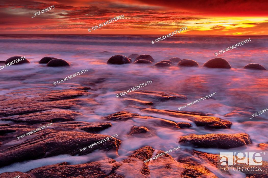 Stock Photo: Moeraki boulders sunrise, incoming tide, Moeraki, Otago.