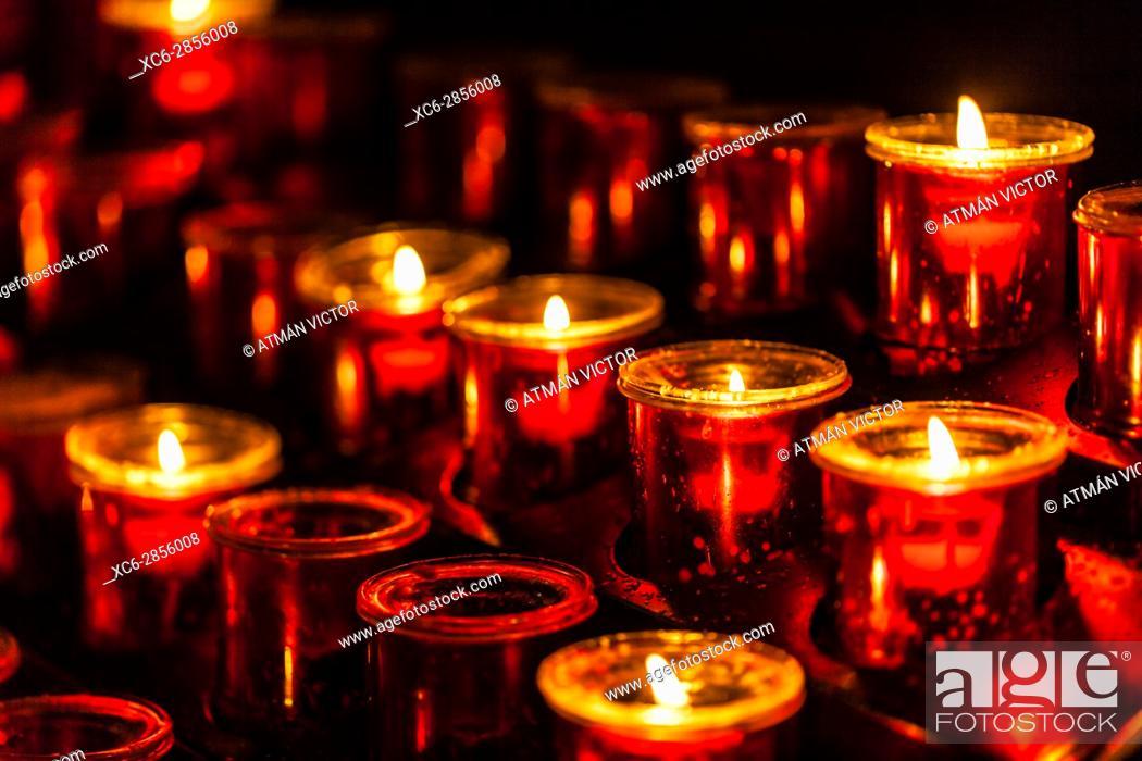 Stock Photo: Lit candle set inside a San Cristobal de La Laguna cathedral.