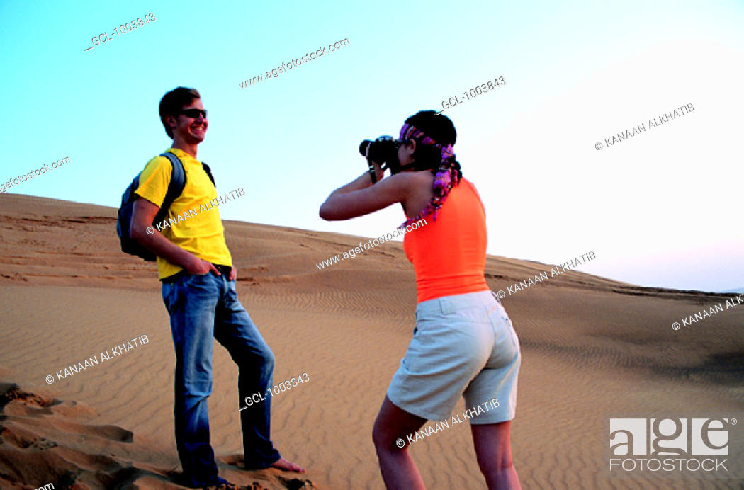 Stock Photo: Western tourist couple in the desert near Hatta, United Arab Emirates.