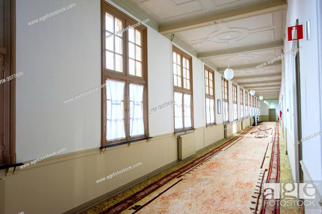 Stock Photo: The Hague, Netherlands. Hallway at the second floor of the Senate building at Binnenhof, with windows on the left, and offices of staff on the right.
