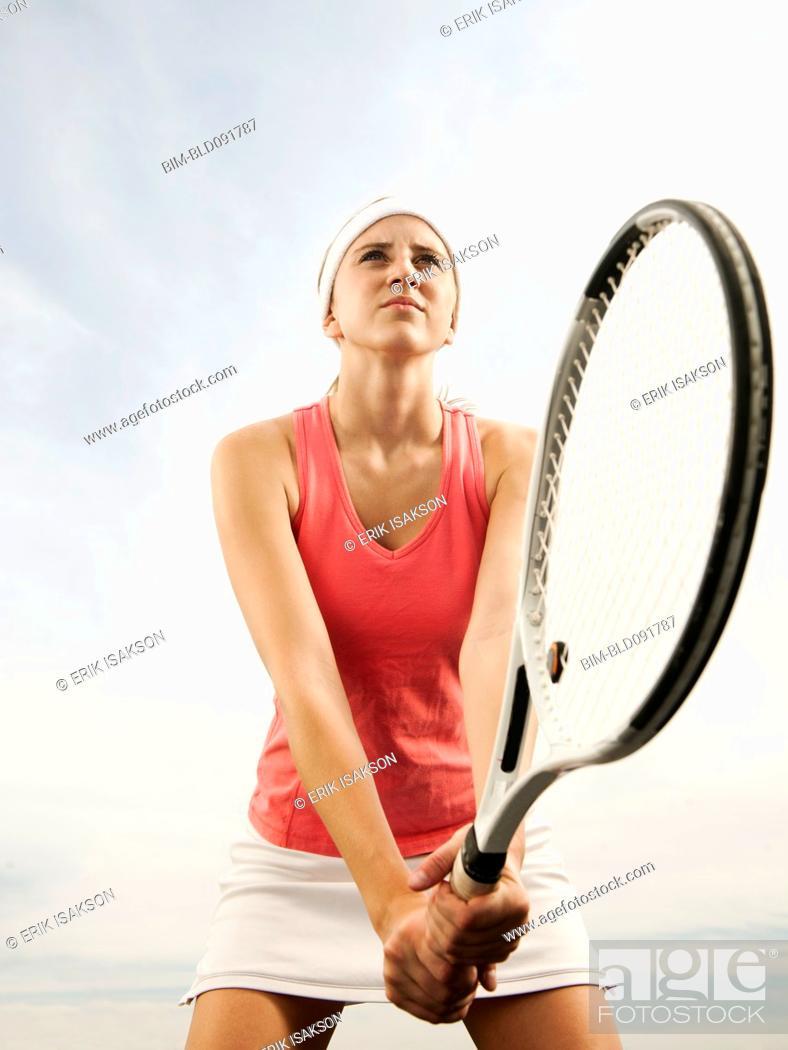 Stock Photo: Caucasian woman playing tennis.