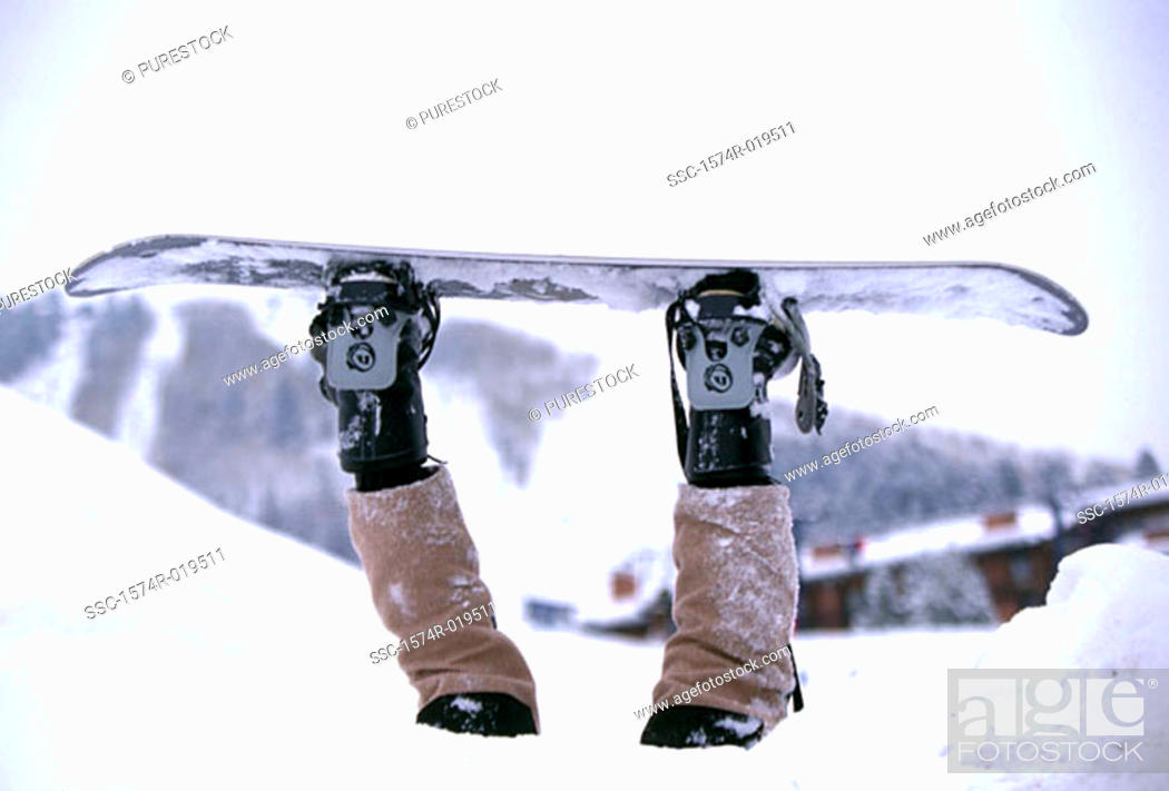 Stock Photo: Person upside down in snow strapped to snowboard.