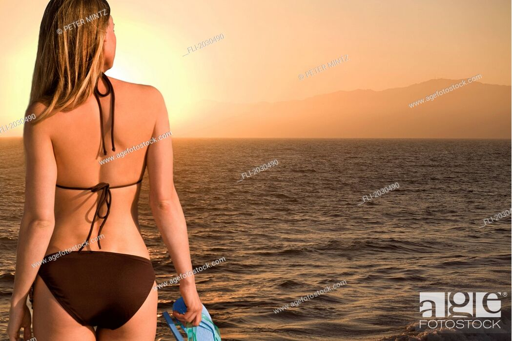 Stock Photo: Women Overlooking The Ocean At Sunset, Los Angeles, California.