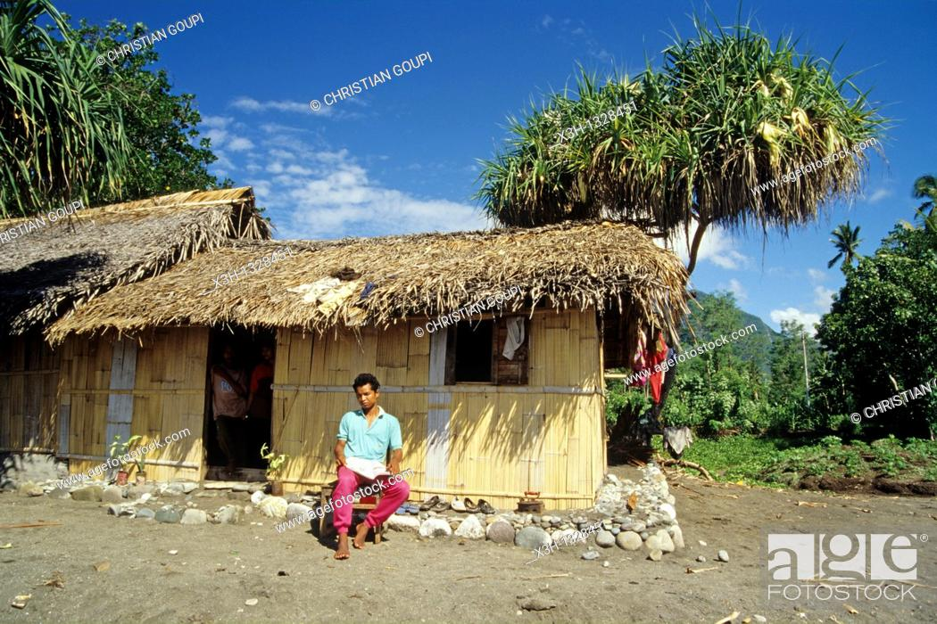 Stock Photo: man in front of his house, Flores island, Lesser Sunda Islands, Republic of Indonesia, Southeast Asia and Oceania.