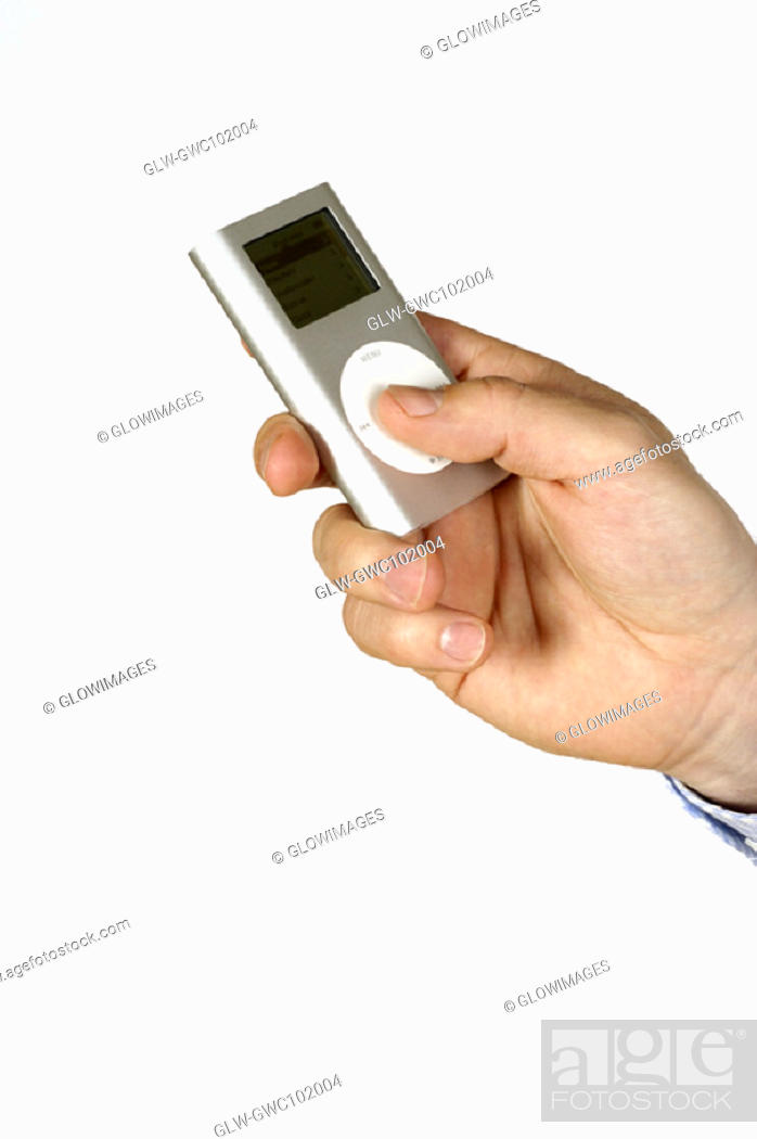 Stock Photo: Close-up of a person's hand holding an MP3 Player.