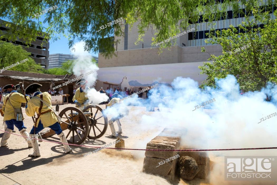 Stock Photo: Tucson, Arizona - Soldiers demonstrate firing a cannon during Living History Day at the Tucson Presidio. The original Spanish fortress was built in 1775.