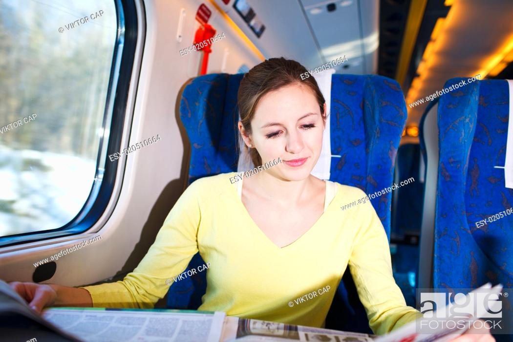 Stock Photo: Young woman traveling by train.