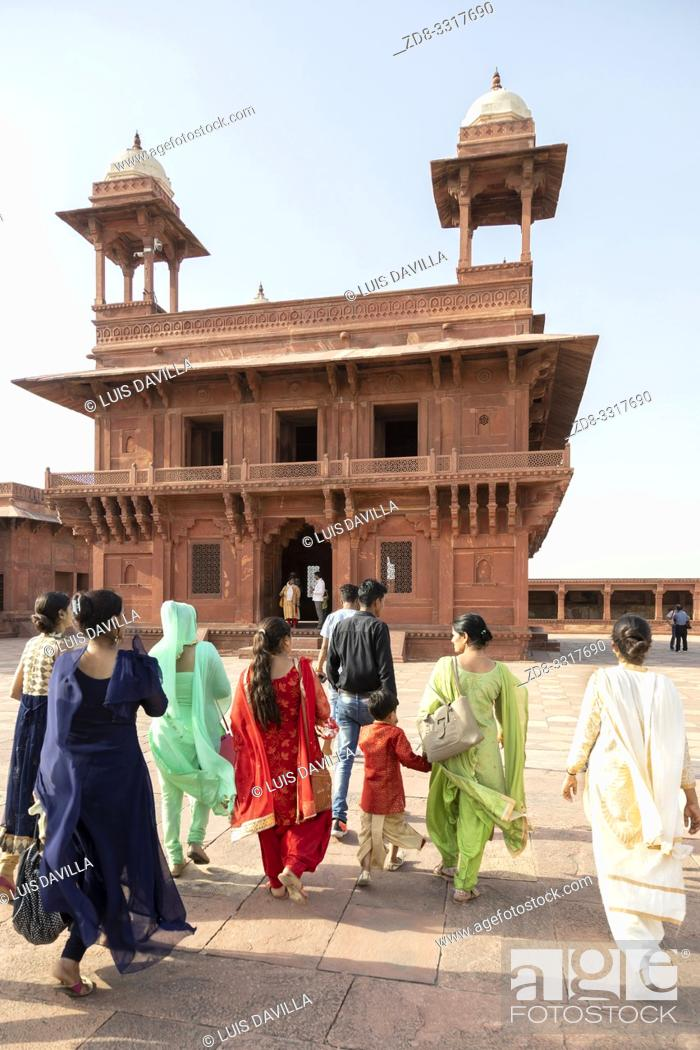 Stock Photo: local family in a Red sandstone buildings of the Fatehpur Sikri complex built by the great Mughal emperor Akbar beginning in 1570 in Fatehpur Sikri, India.