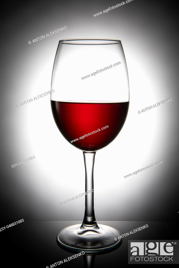 Stock Photo: Glass of red wine, isolated on white background.