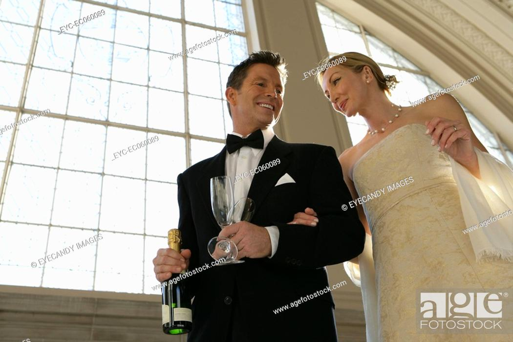 Stock Photo: Mature couple with champagne.