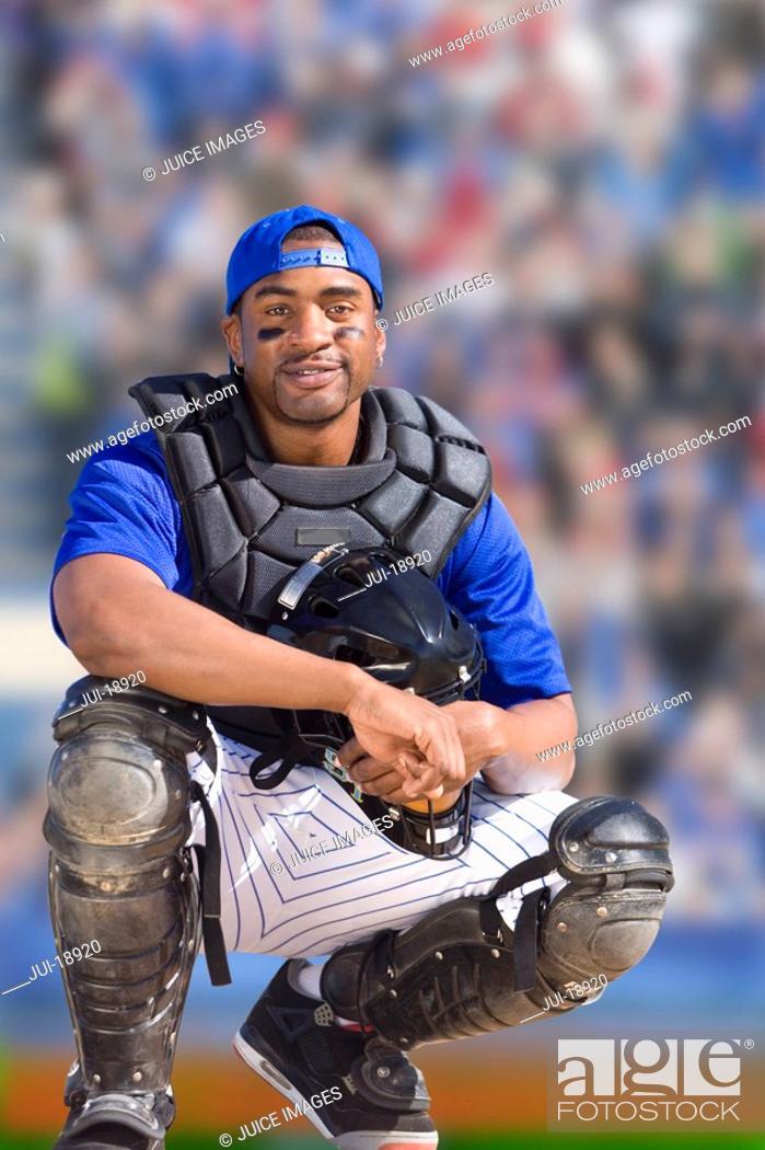Stock Photo: Portrait of smiling baseball catcher.