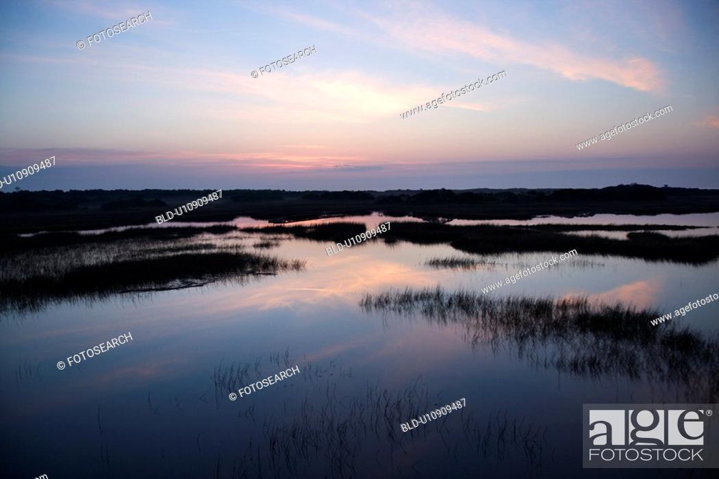 Stock Photo: Sky reflecting water in marsh area on Bald Head Island, North Carolina.