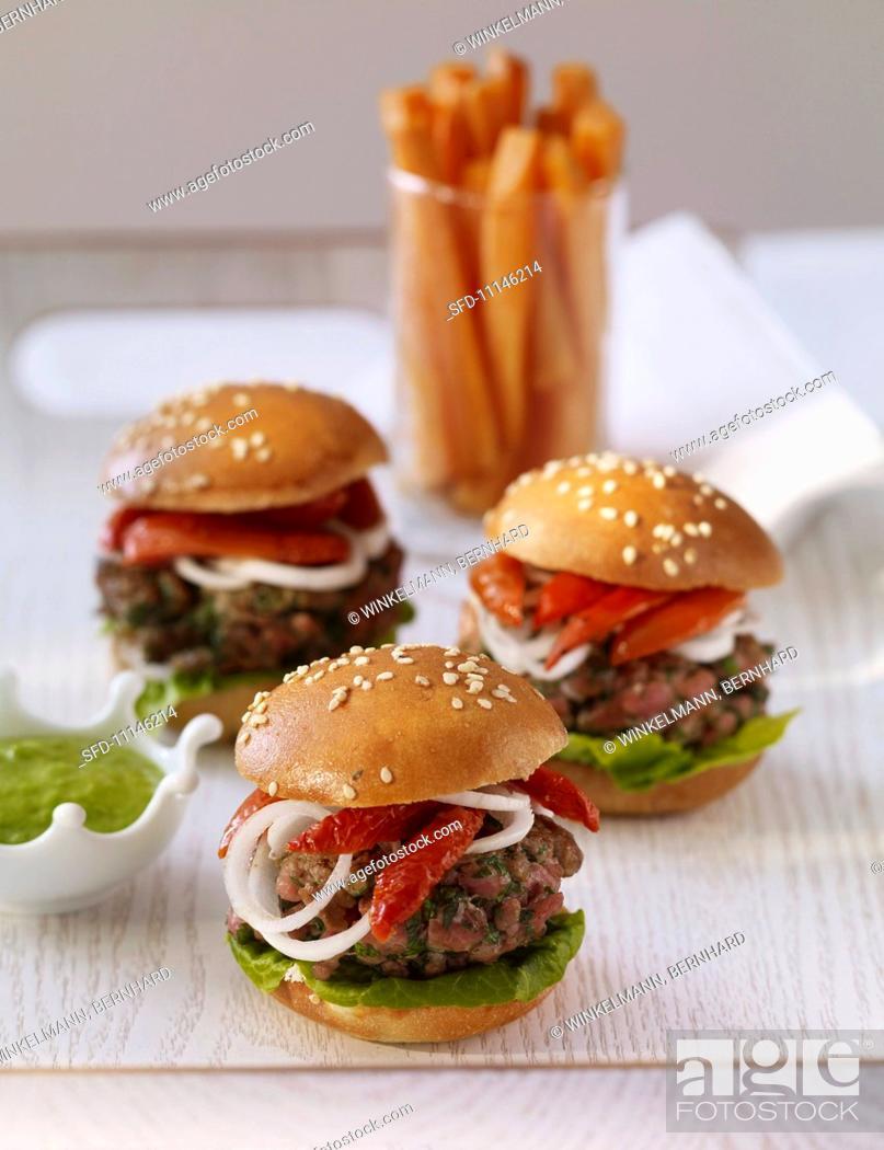 Stock Photo: Three lamb burgers.