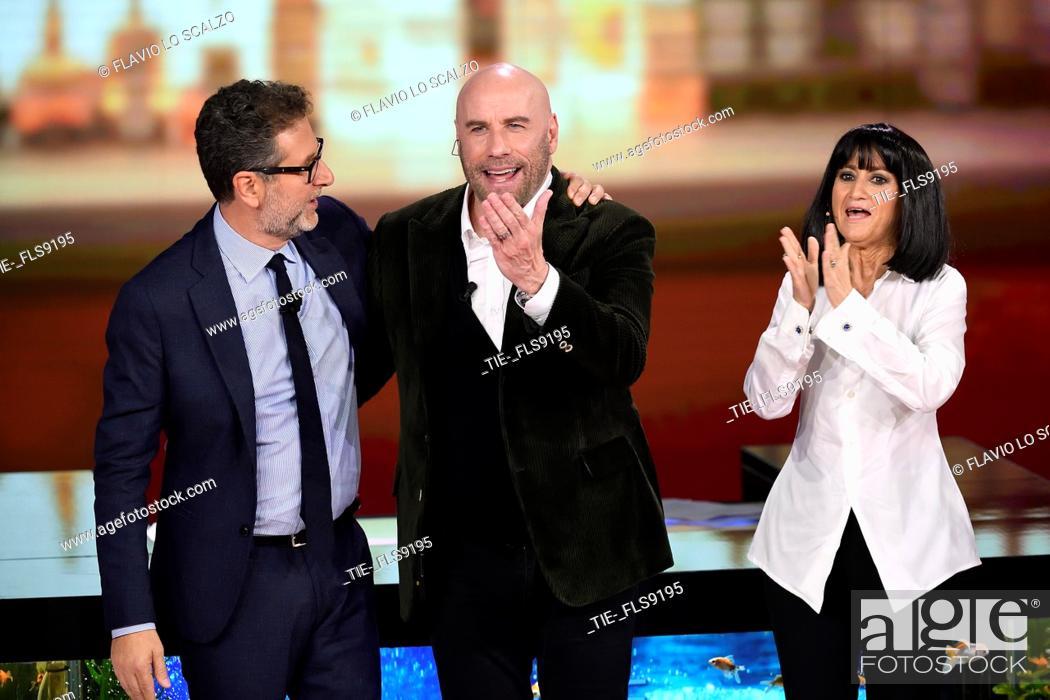 Imagen: Tv conducer Fabio Fazio, actor John Travolta, Luciana Littizzetto during the tv show Che tempo che fa, Milan, ITALY-20-10-2019.