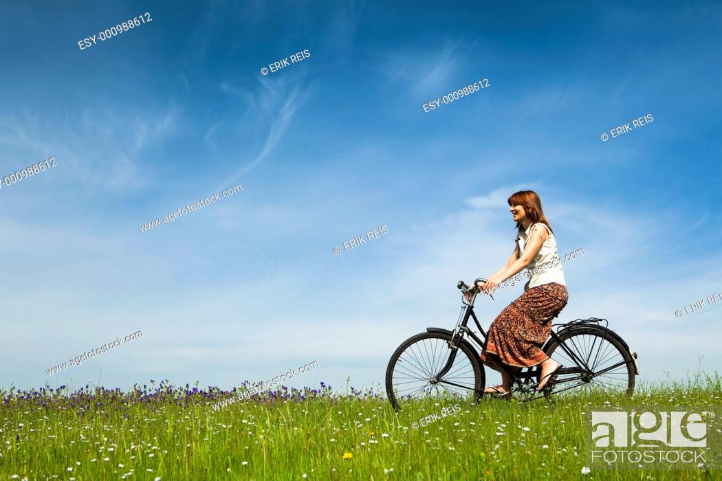 Stock Photo: Girl with a bicycle.