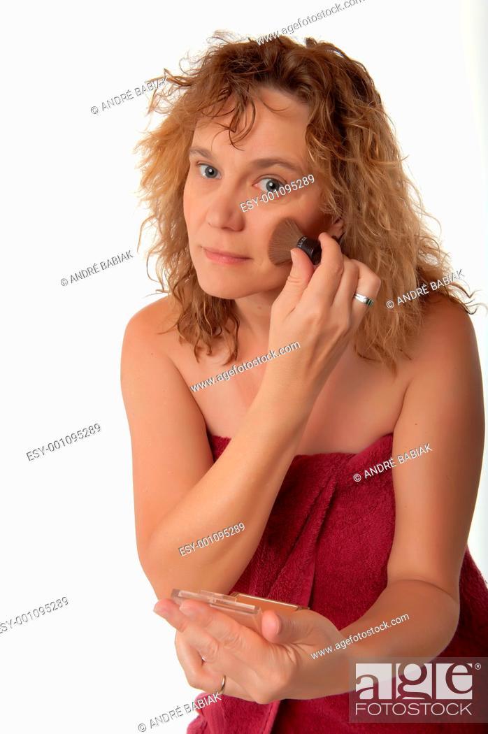 Stock Photo: Woman applying makeup blush with brush.