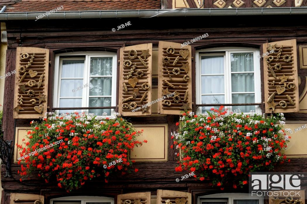 Stock Photo: France, Alsace, Alsace Wine Route, Colmar, old town, residential building, two windows, flowers, detail.