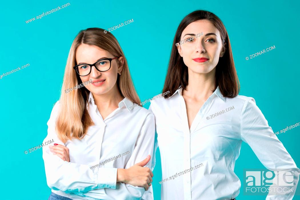 Photo de stock: Portrait of two women in office clothes. Cute attractive businesswomen. Team of two smiling businesswomen posing. two young women business colleagues in a.