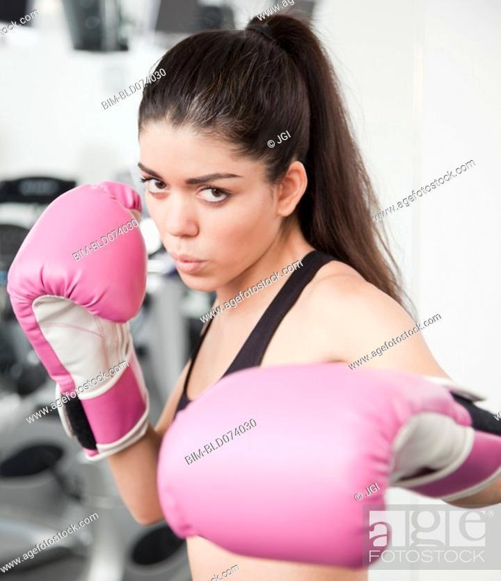 Stock Photo: Hispanic woman boxing.