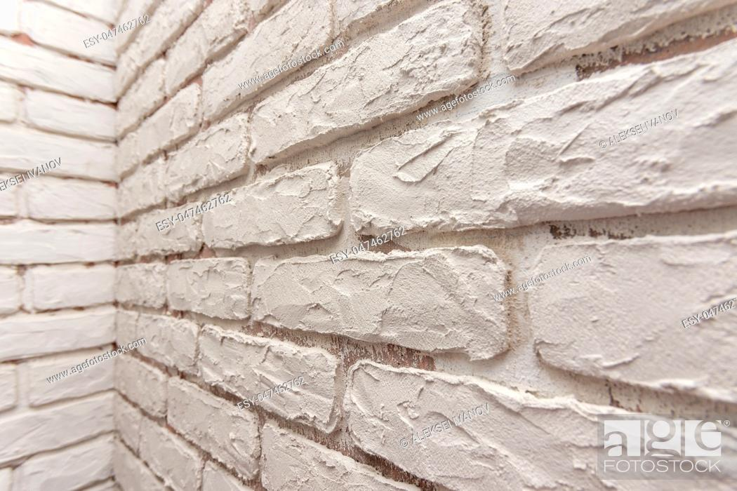 Stock Photo: Designer hand-made imitation brickwork on the wall of the apartment.