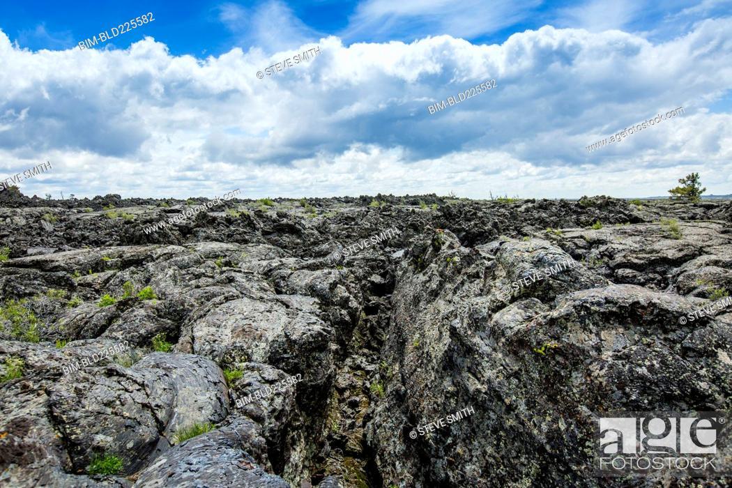Stock Photo: Lava rock under clouds.
