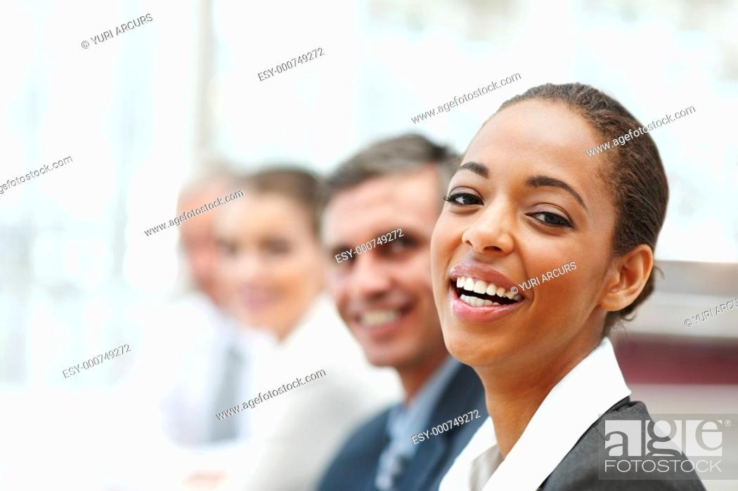 Stock Photo: Closeup image of a laughing African American business woman at a conference.