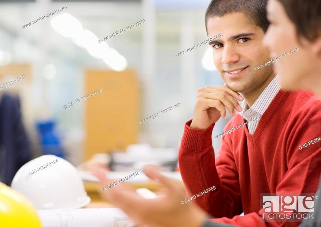 Stock Photo: Two people working together in office.