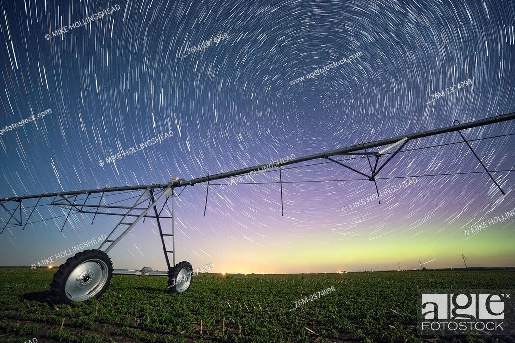 Stock Photo: Auroras dance with the Milky Way above an Iowa farm field.