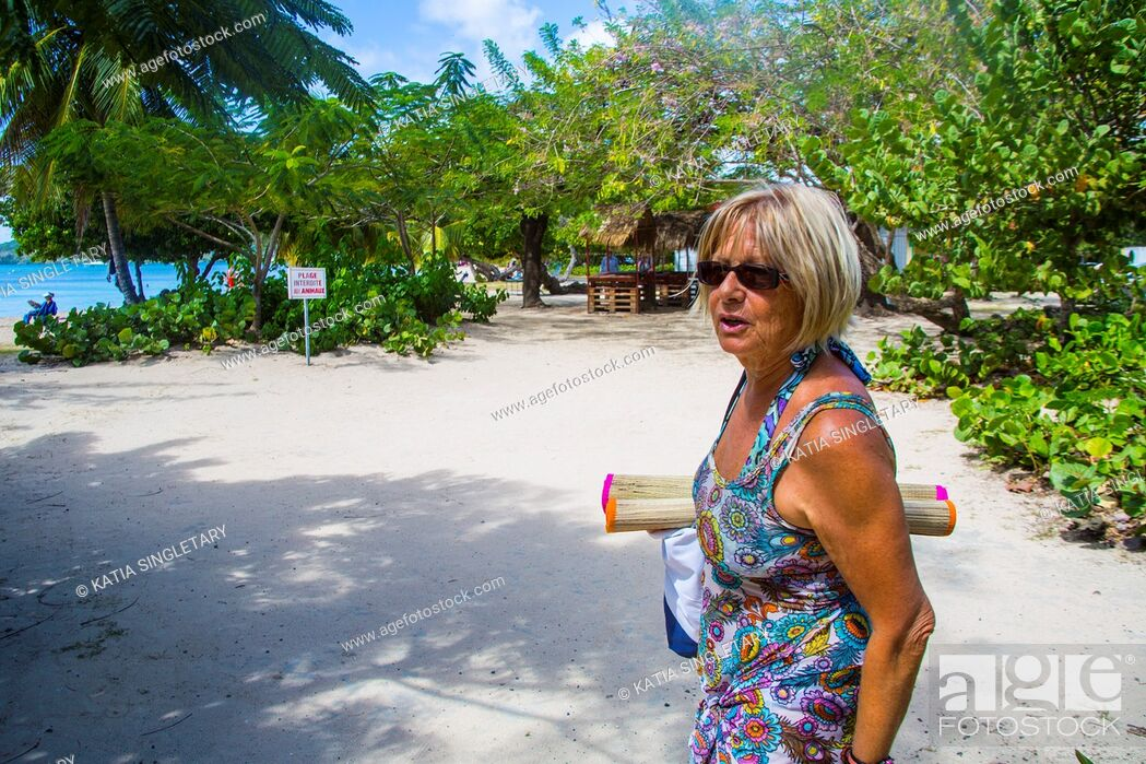 Stock Photo: Caucasian retired senior woman going to the beach in the island of Martinique.