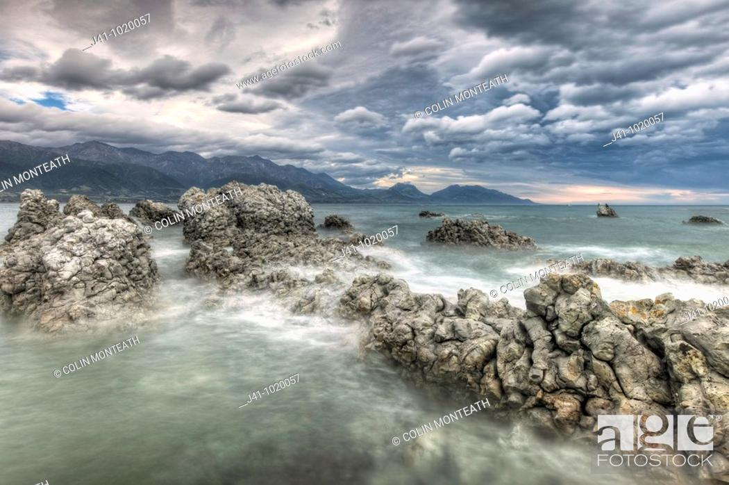 Stock Photo: Nor'west storm clouds, Kaikoura headland, North Canterbury, New Zealand.