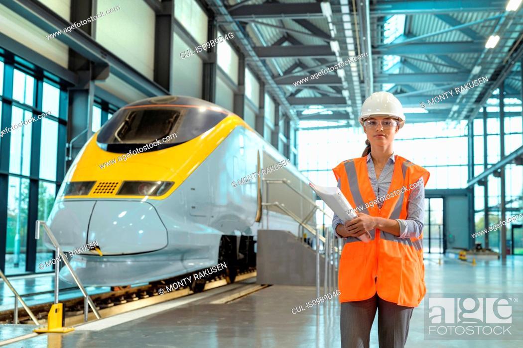Stock Photo: Portrait of female apprentice at railway engineering facility.